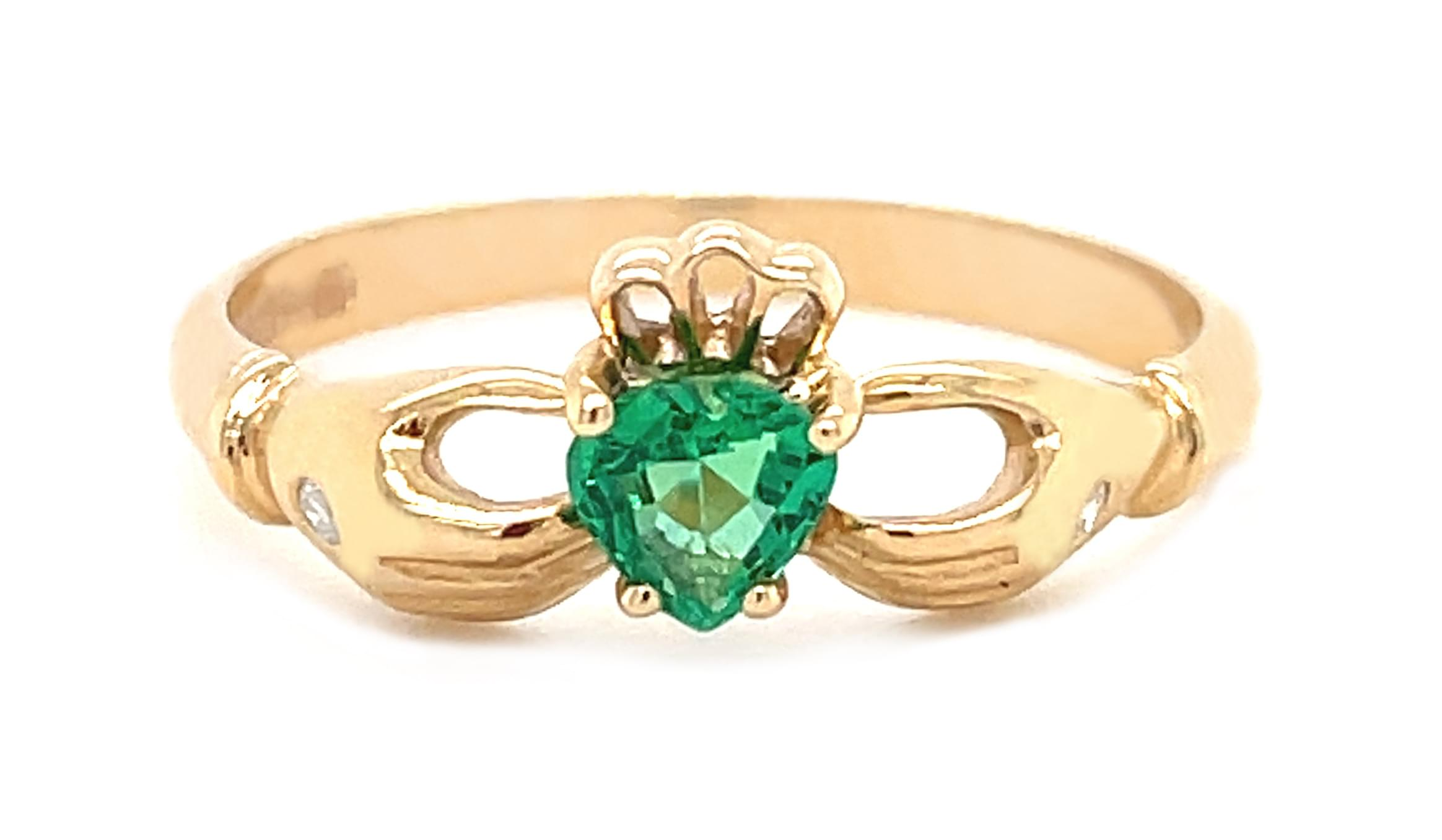 Gold And Emerald Claddagh Ring With Diamond